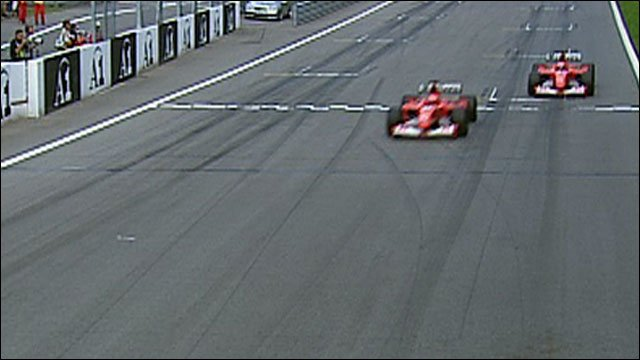 Michael Schumacher overtakes Rubens Barrichello