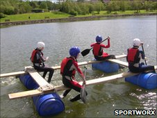 Young people on a  raft, image courtesy of Sportworx