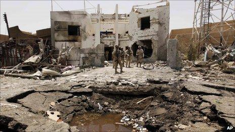 Iraqi soldiers outside the office of Al-Arabiya channel in Baghdad, 26 July