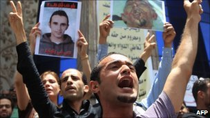 Egyptian political activist Ahmed Abu Doma shouting slogans during a protest in Cairo, 19 June