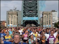 Runners cross the Tyne Bridge
