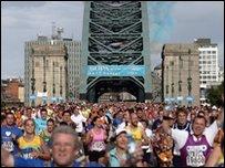 Runners cross the Tyne Bridge