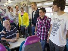 Only Boys Aloud on board a train