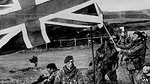 British troops raise the Union flag on the Falklands