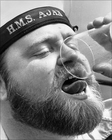 Leading cook Chick Howard, serving on board HMS Ajax, draining his last ever glass of free Navy Rum