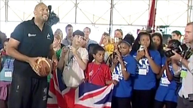 John Amaechi and a crowd of children
