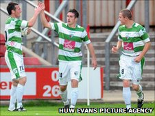 Craig Jones celebrates his goal with his TNS team-mates