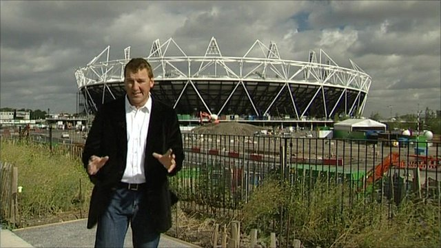 Matthew Pinsent in front of London's Olympic stadium