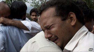 Relatives mourn the deaths of their family members killed in a plane crash, outside a local hospital in Islamabad, Pakistan