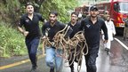Pakistani rescue workers rush to the crash site