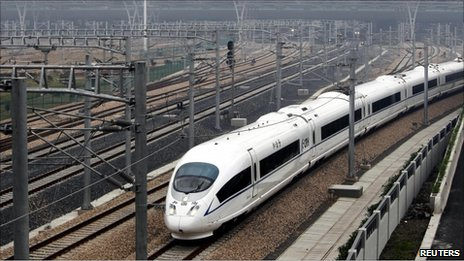 A high-speed train travels on the newly built Shanghai-Nanjing railway in Shanghai July 1, 2010