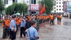 Soldier evacuate local people in Kouqian, Jilin province, China (28 July 2010)