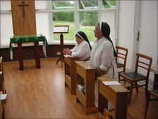Sister Anna-Marie and Sister Valery at prayer