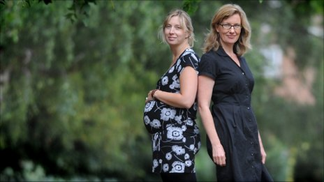 One pregnant, one not (picture posed by models)