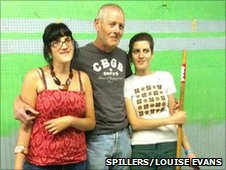 Grace, Nick and Ashli Todd prepare the new premises for Spillers Records