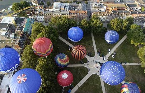 Hot air balloons take off from Queen Square