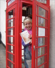 Jane Adams in the Blagdon library in a phone box