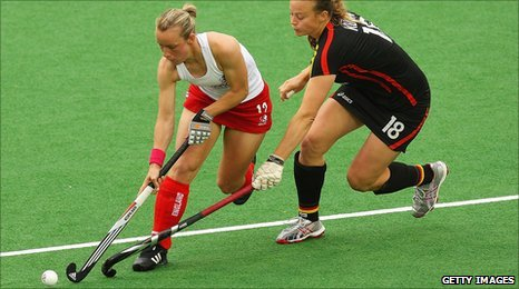 Chloe Rogers battles against Germany on the hockey pitch