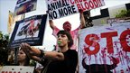 Animal rights activists protest across the street of the only remaining bullfighting ring in Barcelona, Plaza Monumental