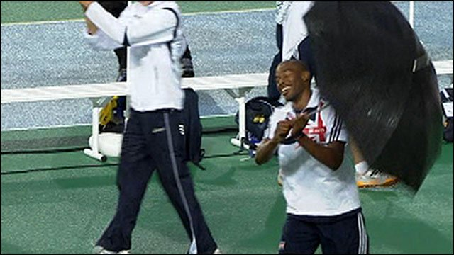 Great Britain's Martyn Bernard dancing with an umbrella