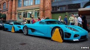 Koenigsegg CCXR and a Lamborghini Murcielago LP670-4 SuperVeloce clamped outside Harrods