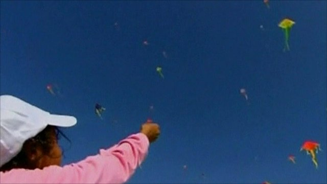 A child flies a kite in Gaza