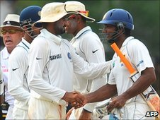 Harbhajan Singh of India and Sri Lanka captain Kumar Sangakkara shake hands