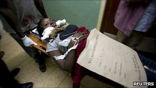 An injured woman in hospital after Kampala bombing
