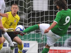 Northern Ireland's William Grigg fires on the USA goal in the final