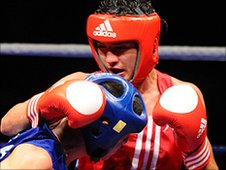 Andrew Selby (red) takes on Jiwal Zhang