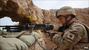 A soldier keeps watch from a newly occupied compound in Helmand (pic supplied by MoD)
