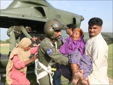 Pakistani soldiers evacuate stranded villagers near Nowshera, Pakistan on July 30, 2010