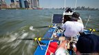 The rowing crew in New York harbour with Manhattan skyline behind them (Copyright: Artemis Ocean Racing)