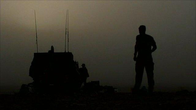Soldier walking towards tank