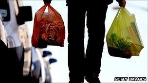 Man carrying plastic bags