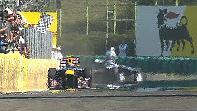 Mark Webber takes the chequered flag