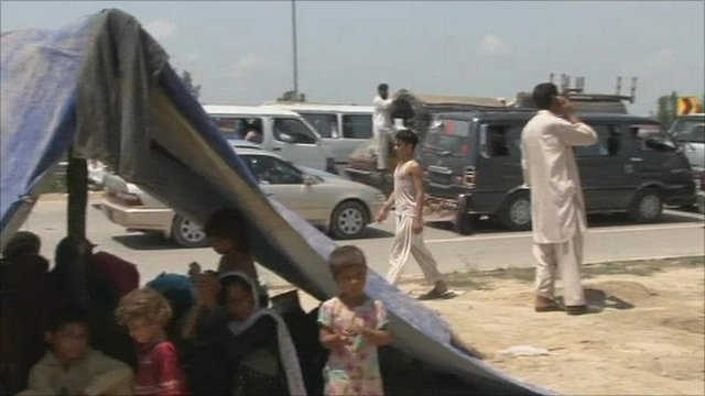 Refugees on the road out of the flood-hit region
