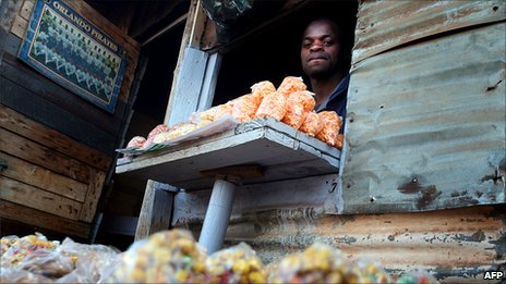 Phineas Lucky Nobela from Mozambique stands in his shop at the Winnie Mandela informal settlement in Tembisa township, north-east of Johannesburg
