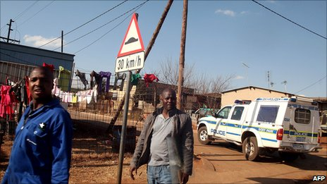 A police car patrols at the Winnie Mandela informal settlement in Tembisa township, north-east of Johannesburg