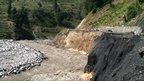 Damaged road and river: Photo: Furqan Ullah