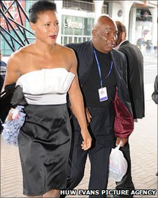 Earnie Shavers enters Cardiff International Arena with Cecilia Braekhus for the WBC Night of Champions