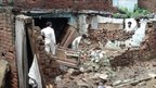 Men working in collapsed building. Photo: Furqan Ullah