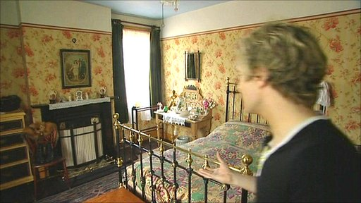 Peter Saunders shows off the master bedroom in his restored Victorian cottage in Kimberley, Nottinghamshire
