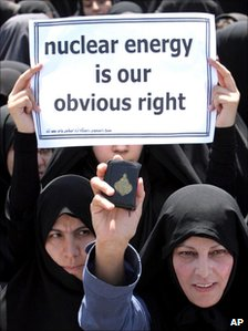 A woman holds up a Koran during a protest in support of Iran's nuclear programme just outside Isfahan, south of Tehran, 16 August 2005