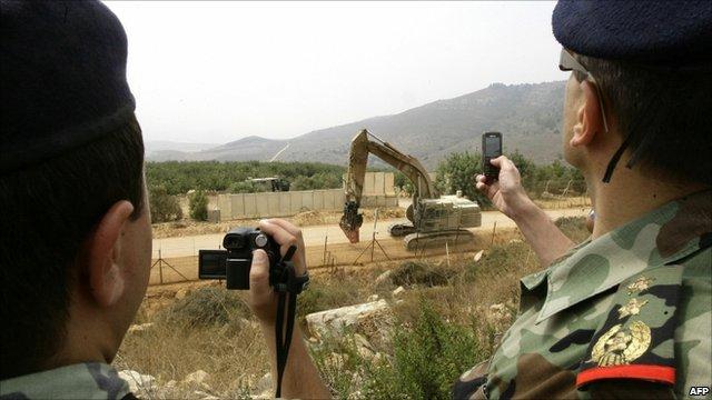 Lebanese military film as Israelis clear trees along border