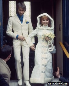 Scottish pop singer Lulu emerges from Gerrards Cross Church, Buckinghamshire with her new husband, Maurice Gibb