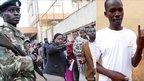Jacob Kosgei in Eldoret (right); a policeman during polling in Eldoret (left)