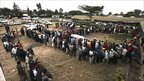 Kenyans line up to vote at a polling station in Ngong Town, Kenya, Aug. 4 2010
