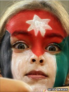 Girl with Jordan flag facepaint