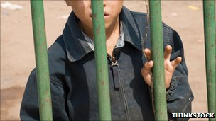 Generic image of boy behind bars